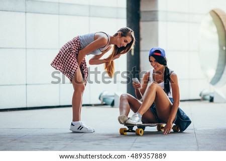 two young adult women with lonboard