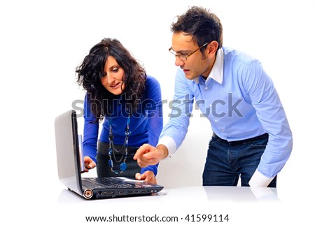 two young adults working on the pc laptop