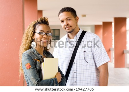 Two young african college students standing in the passage before going to the classroom - stock photo