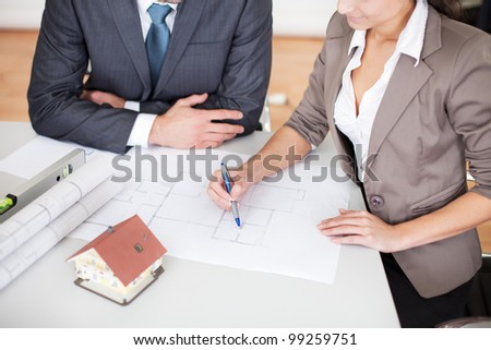 Two young architects at the office in the meeting - stock photo