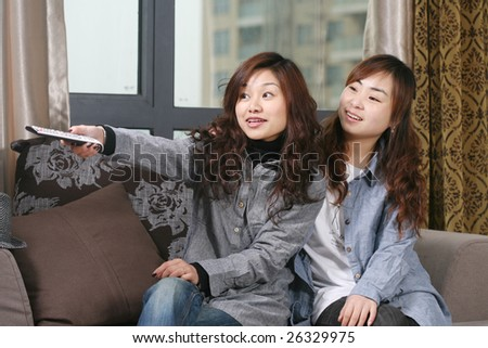 two young asia women at home - stock photo