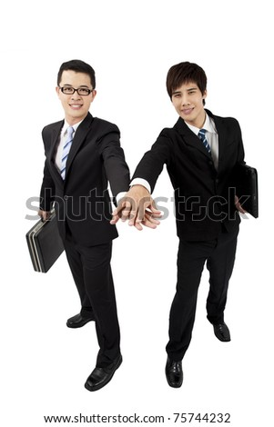 Two young asian   businessman with touch hands - stock photo