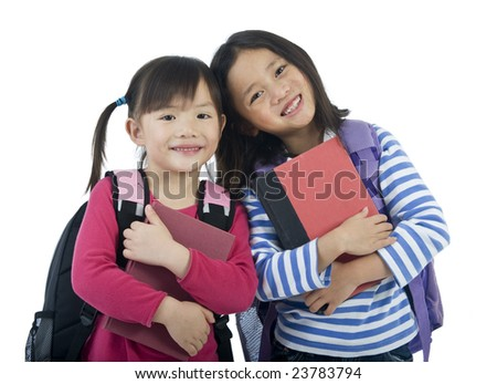 Two young asian school girls ready for school