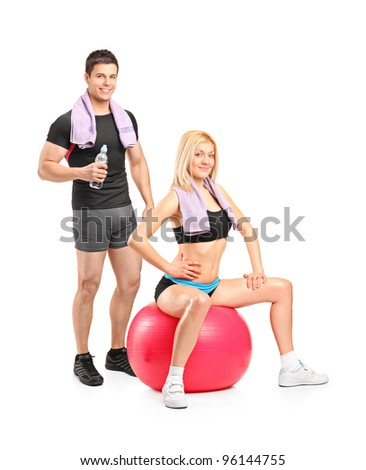 Two young athletes posing isolated on white background - stock photo