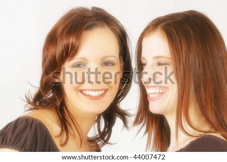 Two young Australian women in studio smiling at each other