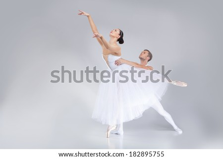 two young ballet dancers practicing. attractive dancing performers acting on stage