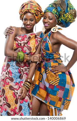 Two young beautiful african fashion modesl on white background. - stock photo