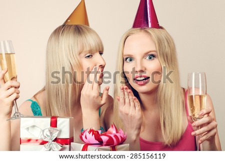 Two young beautiful blonde women celebrating birthday