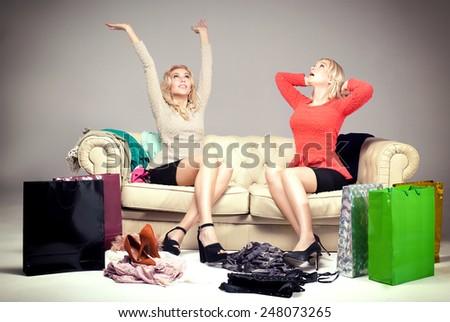 Two young beautiful girls enjoying shopping. Happy friends. - stock photo