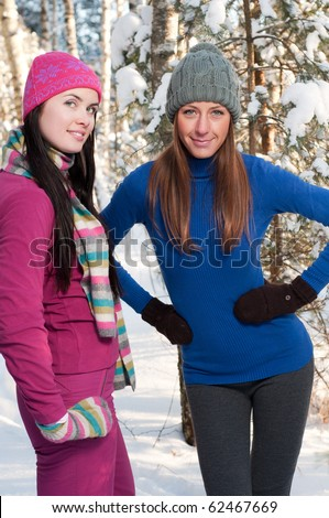 Two young beautiful girls in winter - stock photo