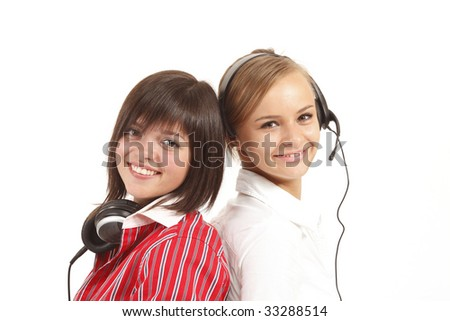 Two young beautiful women smile. It is isolated on a white background.