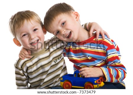 Two young boys cheerfully play - stock photo