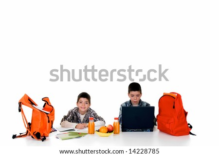 two young boys doing together studying and homework - stock photo