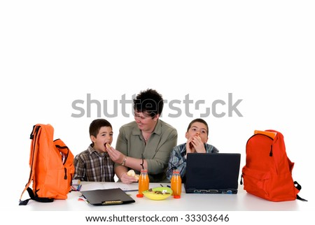 two young boys doing together studying and homework with the support of the mother - stock photo