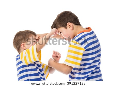 Two young boys fighting, isolated in white - stock photo