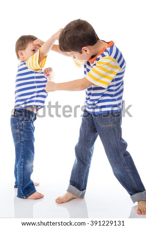 Two young boys fighting isolated in white - stock photo