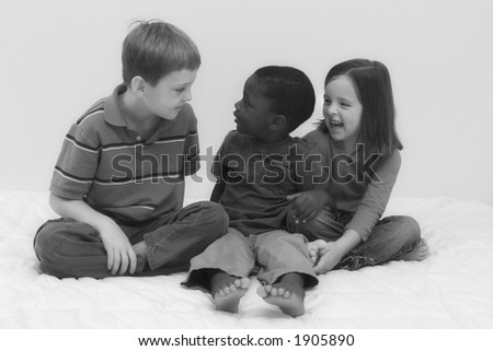 Two young boys of different races playing together. - stock photo