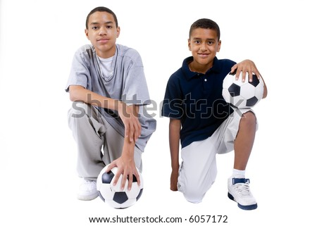 two young boys with a soccer balls. isolated on white