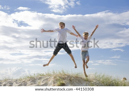 two young brothers at the beach
