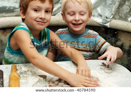 Two young brothers making christmas gingerbread cookies