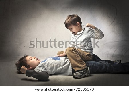 Two young brothers quarreling - stock photo