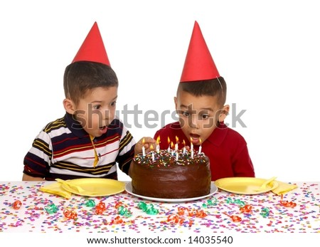 Two young brothers ready to enjoy a birthday cake - stock photo