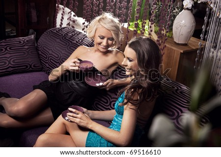 Two young brunettes having fun on afternoon coffee