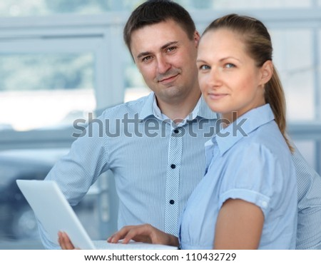 Two young business colleague working together in office - stock photo