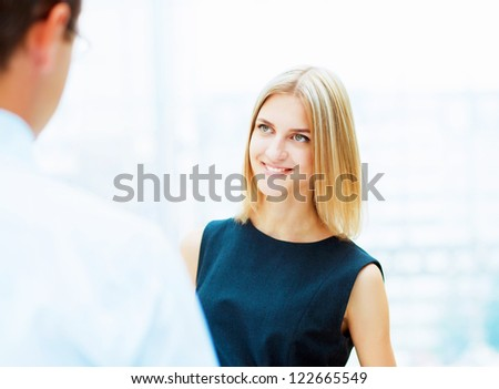 Two young business collegue working together in office - stock photo