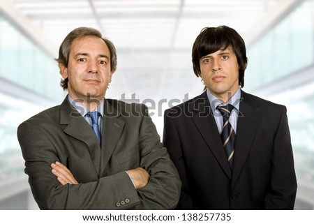 two young business men portrait, at the office - stock photo