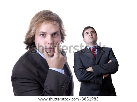 two young business men portrait on white. focus on the man of the right
