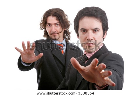 two young business men portrait on white. focus on the right man... - stock photo
