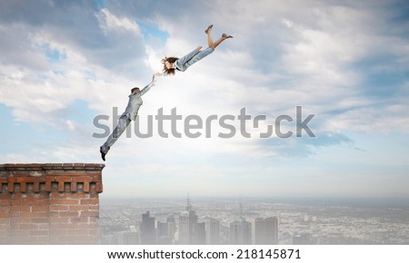 Two young business people flying in sky