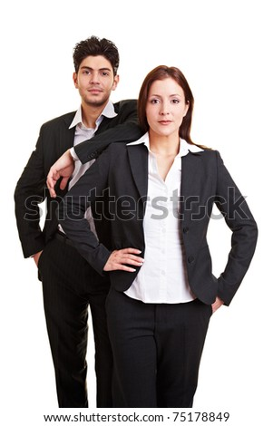 Two young business people in suits looking seriously - stock photo