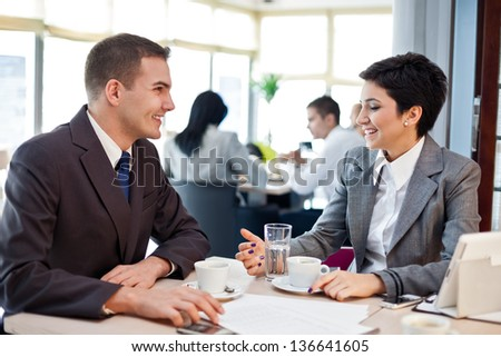 two young business people on meeting in restaurant