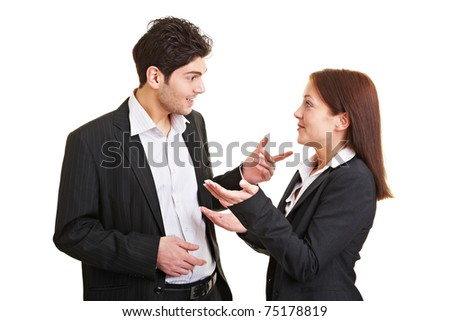 Two young business people talking and discussing
