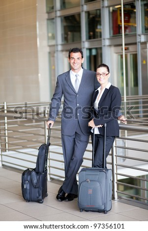 two young business travellers at airport - stock photo