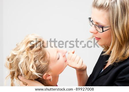 Two young business women fighting. - stock photo