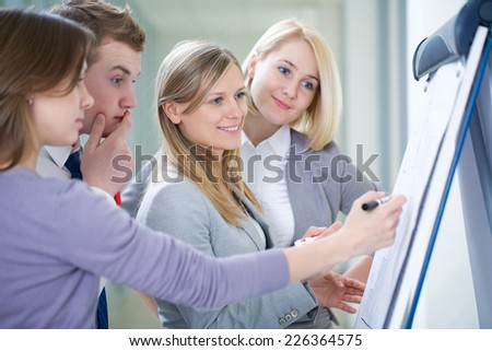 two young business wonen used tablet PC - stock photo