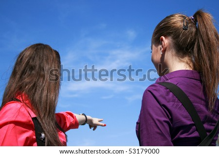 Two young businessladies looking ahead - stock photo