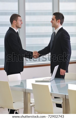 two young businessman handshake on business meeting at modern office and representing success - stock photo