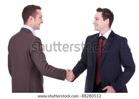 two young businessman handshake on business meeting over white background - stock photo