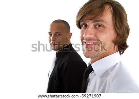 Two young businessman - one asian and one caucasian isolated over white background.