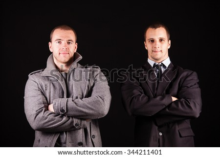 Two young businessman over black background - stock photo