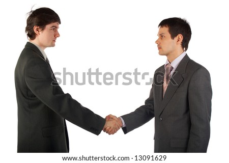 Two young businessmen handshake isolated on white
