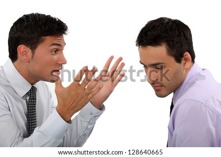 Two young businessmen having an argument - stock photo