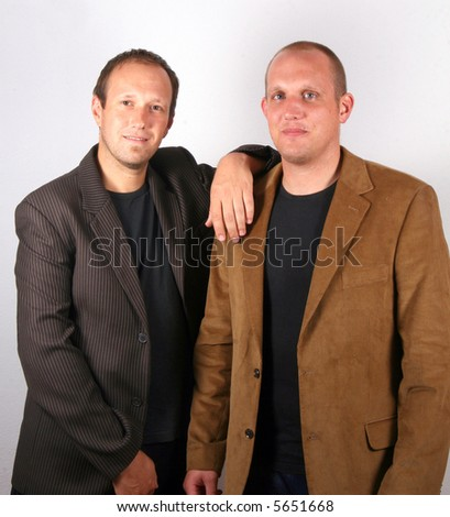 Two Young Businessmen Two you businessmen stand like partners. Isolated studio shot! - stock photo