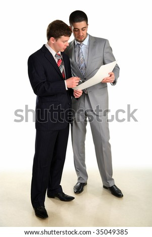 Two young businessmen working and confer - stock photo