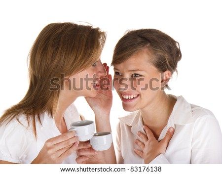 Two young businesswoman speaking quietly and drinking coffee/Gossip in office/Gossip in office