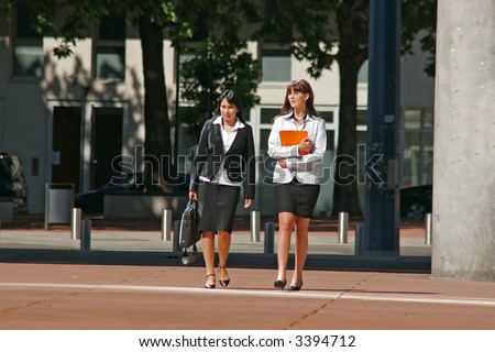 Two young Businesswomen going downtown